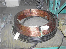 Copper wire containing insulation is often transported to burn sites where the insulation is burned off in a steel drum leaving behind just the copper wire.