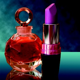 Bottles of Perfume and Lipstick