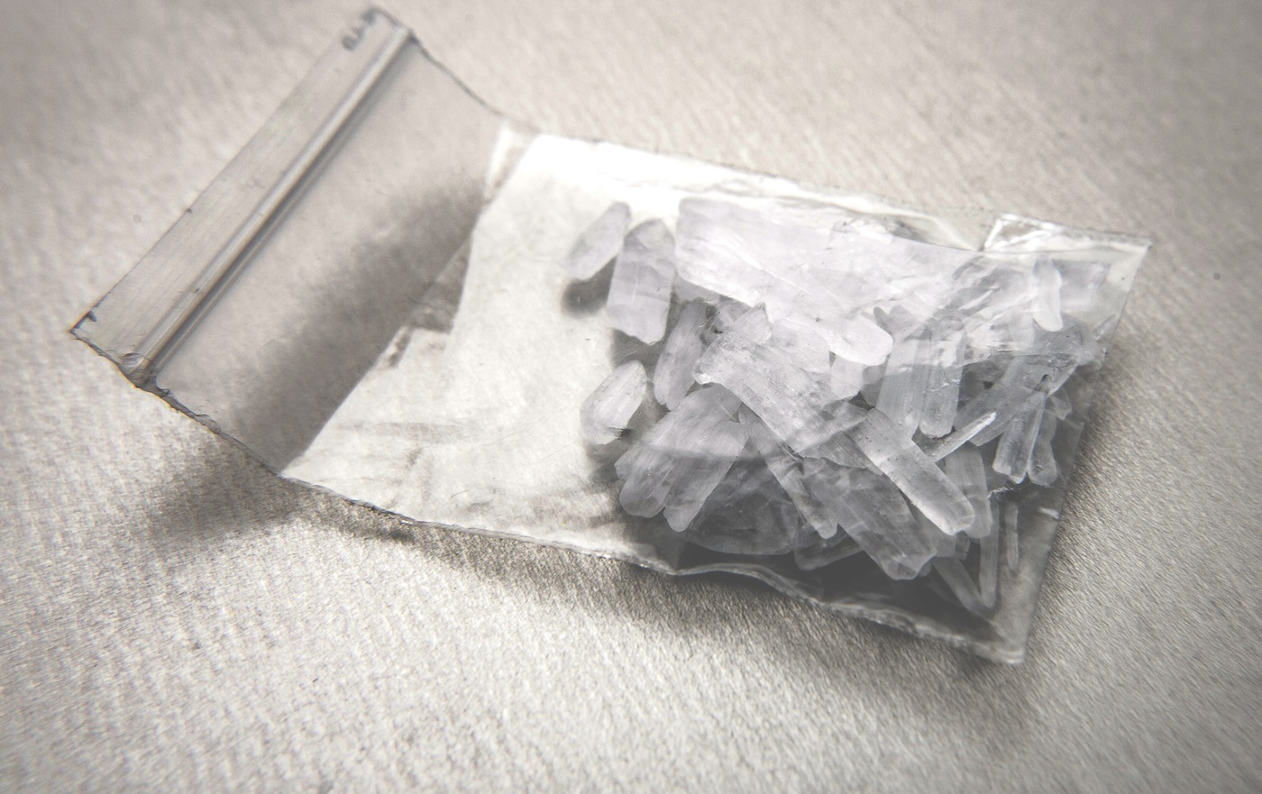 Stock image of a bag of methamphetamine in the form known as crystal meth.