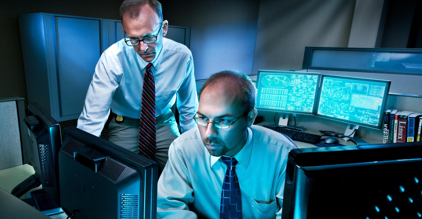 FBI cyber agents at work at a computer.