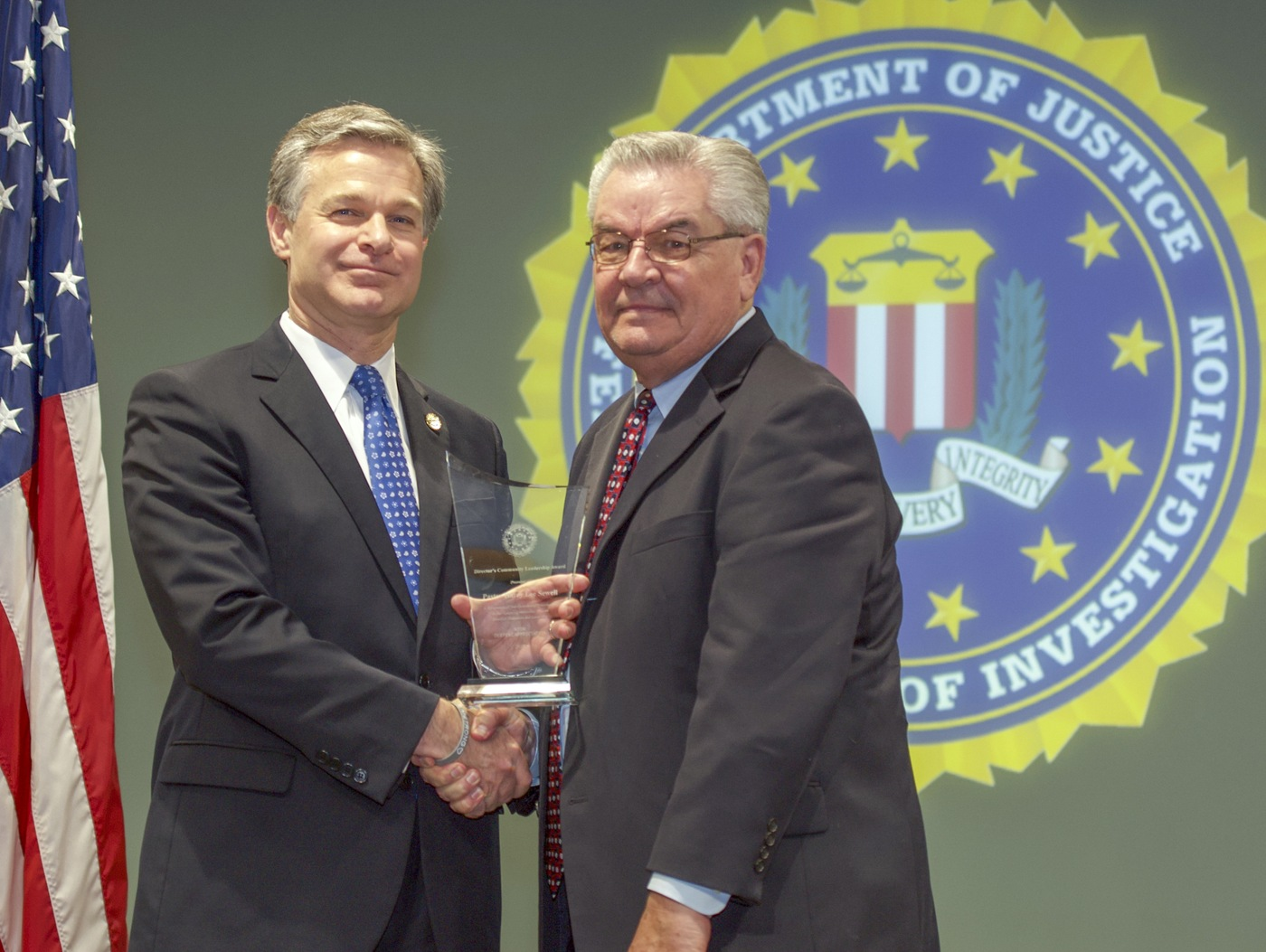 FBI Director Christopher Wray presents Dallas Division recipient Pastor Harry Lee Sewell with the Director's Community Leadership Award (DCLA) at a ceremony at FBI Headquarters on May 3, 2019.