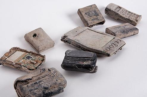 Damaged cell phones and pagers recovered from World Trade Center rubble.