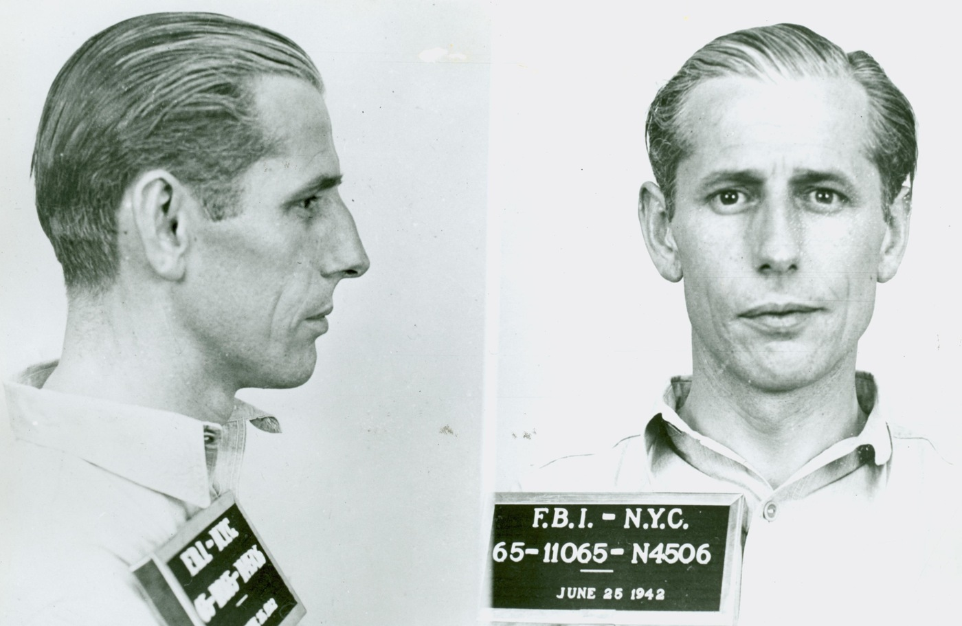 A June 1942 mug shot of George John Dasch, Nazi saboteur, who was offloaded by a u-boat at Amangansett, Long Island, New York. He turned himself in to the New York FBI, was tried, sentenced to 30 years, and ultimately pardoned and deported to Germany.