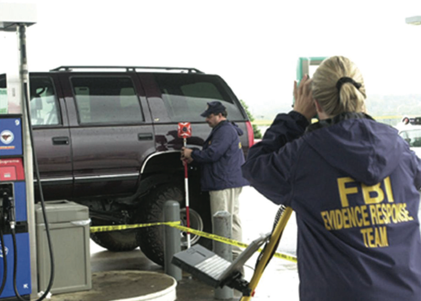 FBI evidence experts surveying a crime scene during the D.C. Beltway sniper case in October 2002. John Allen Muhammed and Lee Boyd Malvo used a hole in the trunk of their Chevy Caprice to shoot 10 victims.