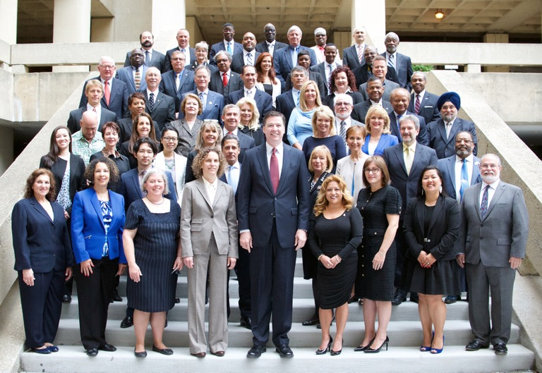 Recipients of the 2014 Director's Community Leadership Award pose with FBI Director James Comey. The Bureau has been presenting its awards for more than two decades to ordinary citizens and organizations striving to build stronger, safer, and more cohesive communities.