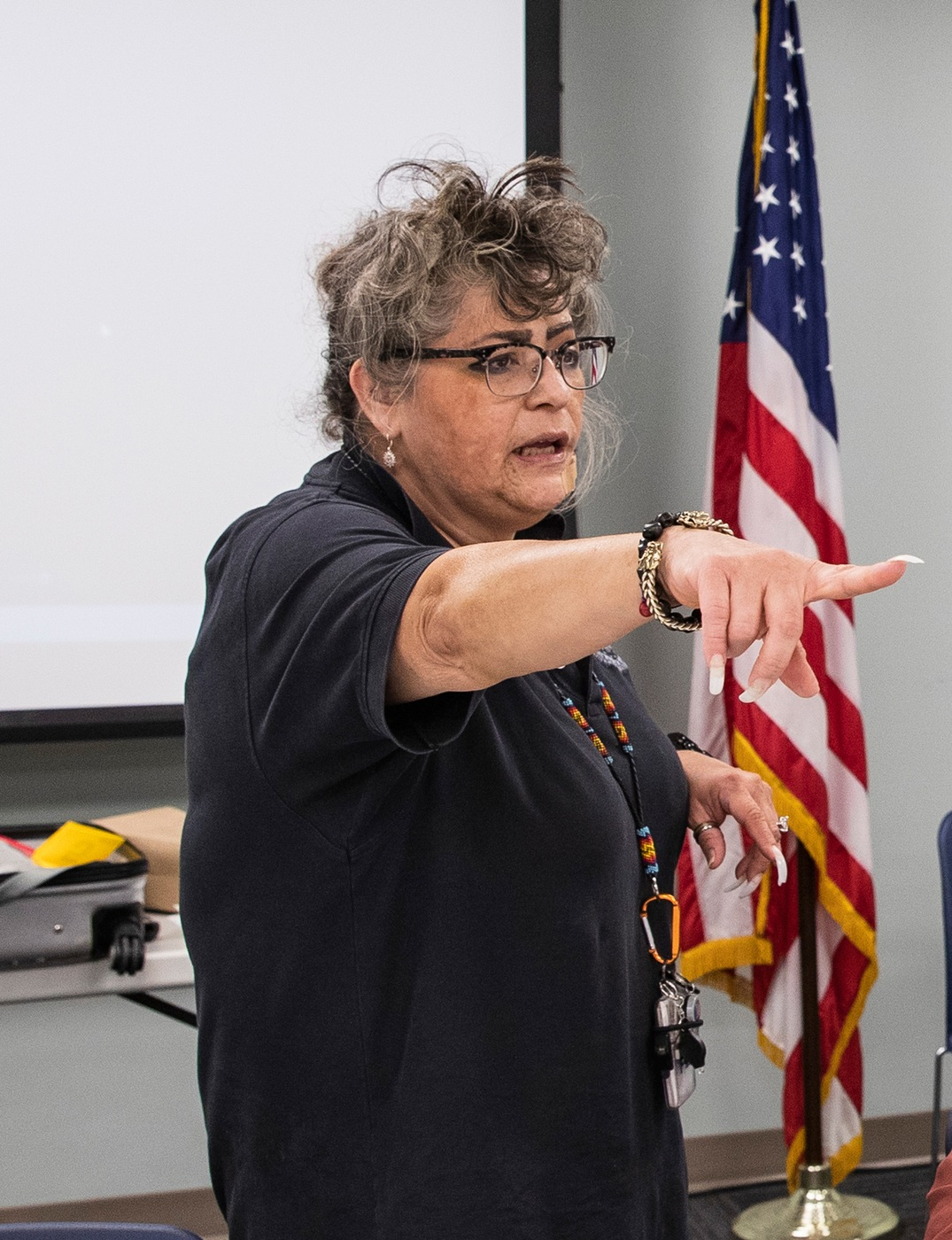 FBI Cryptanalyst Deneen Hernandez speaks about forensic science careers to a group of Native American high school students at FBI Headquarters in Washington, D.C. in summer 2019.