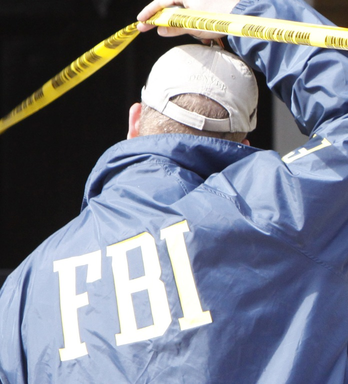 An FBI agent outside the apartment of Najibullah Zazi in Aurora, Colorado on September 16, 2009. AP Photo.