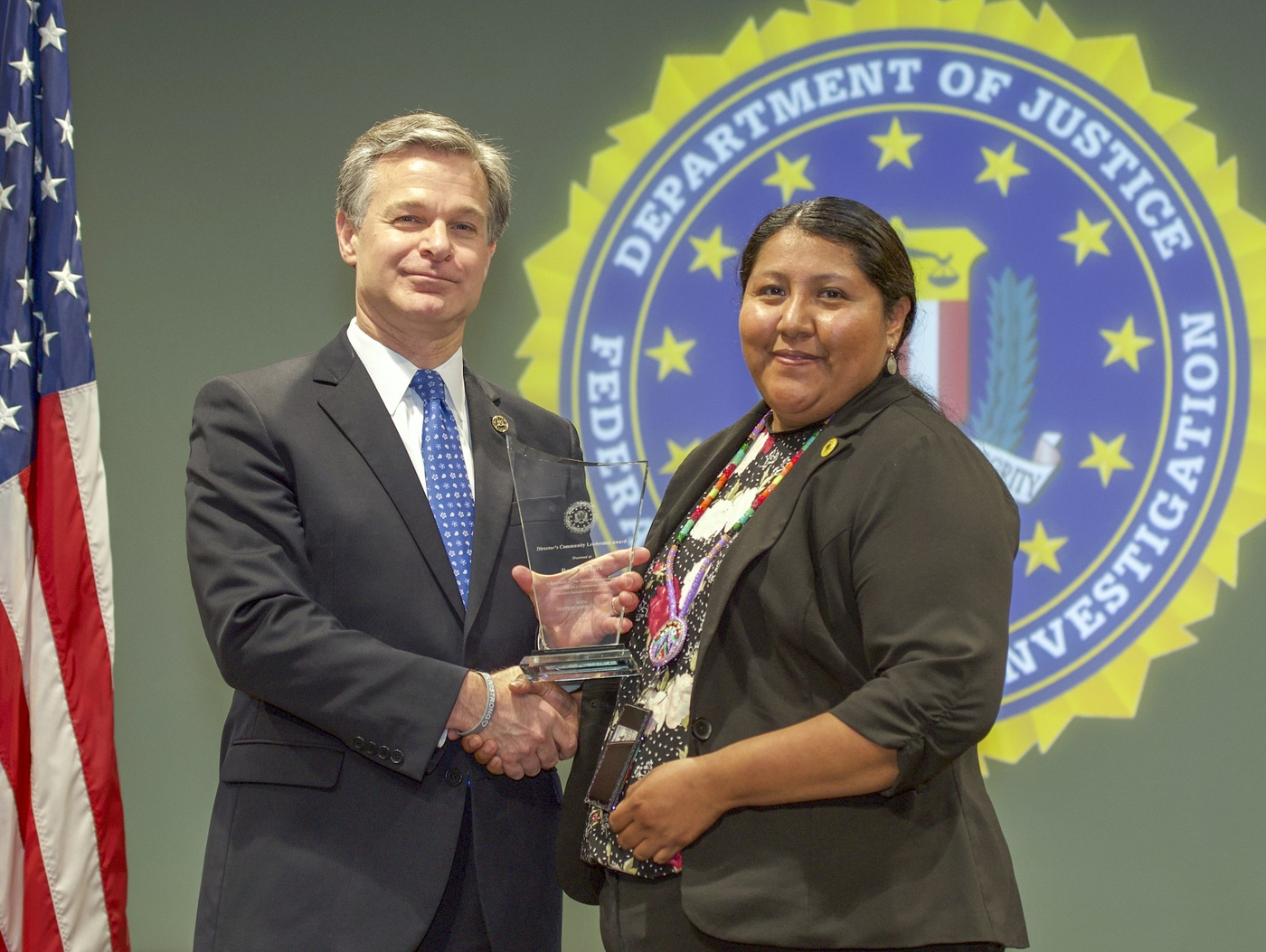 FBI Director Christopher Wray presents Denver Division recipient Rory Tendore with the Director's Community Leadership Award (DCLA) at a ceremony at FBI Headquarters on May 3, 2019.