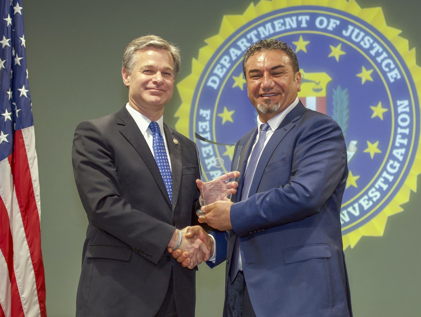 FBI Director Christopher Wray presents Detroit Division recipient Youssef Joe Bazzi with the Director's Community Leadership Award (DCLA) at a ceremony at FBI Headquarters on May 3, 2019.