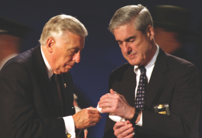 Representative Steny H. Hoyer, left, and FBI Director Robert S. Mueller at the candlelight vigil for fallen law enforcement officers in May 2011.