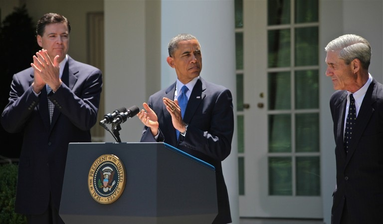 Director Mueller is recognized by President Obama at a ceremony announcing the nomination of James Comey as Director of the FBI in June 2013.
