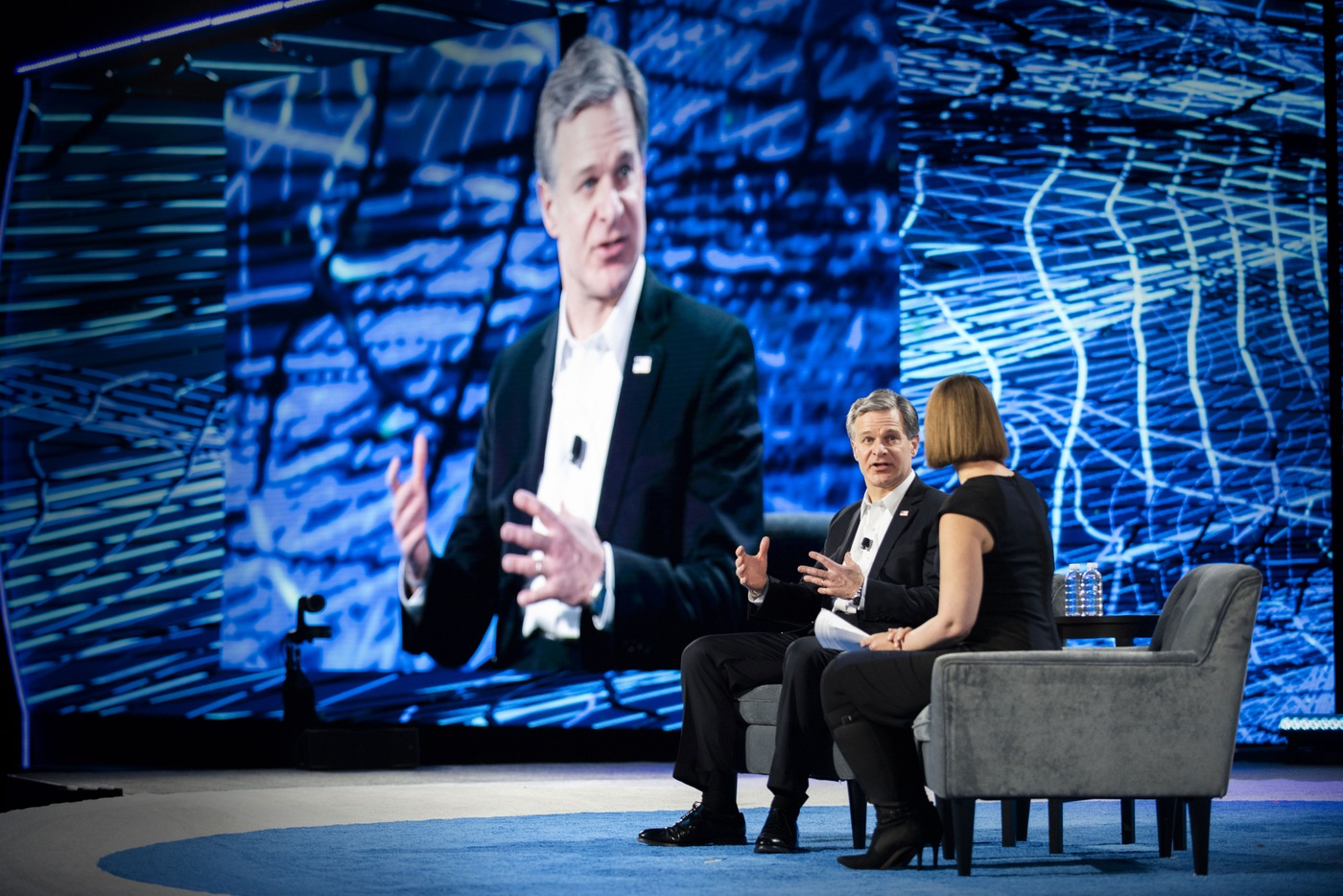 FBI Director Christopher Wray participates in a discussion with Brookings Institute security analyst Susan Hennessey during the 2019 RSA Conference on March 5, 2019, in San Francisco, California.