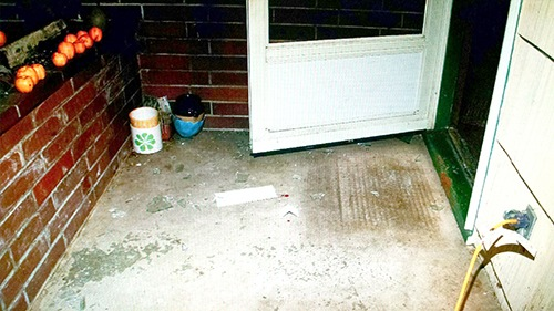 Home Invasion Victimsa Open Front Door with Glass on the Ground