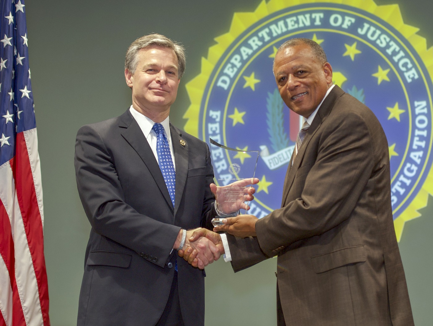 FBI Director Christopher Wray presents El Paso Division recipient Gregory Dwayne Davis with the Director's Community Leadership Award (DCLA) at a ceremony at FBI Headquarters on May 3, 2019.