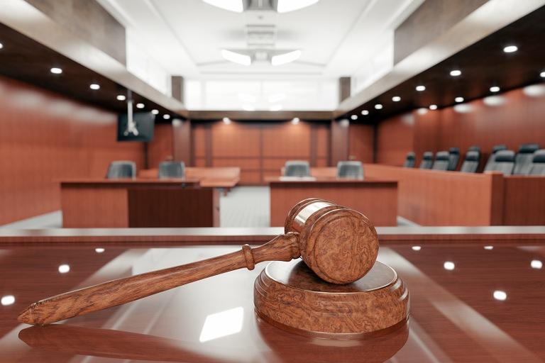 Gavel in Empty Courtroom (Stock Image)