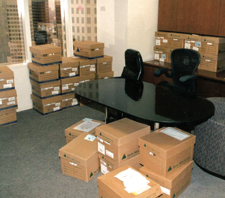 Boxes of evidence in an office at Enron headquarters in Houston in 2002. More than 3,000 boxes of evidence and more than four terabytes of digitized data were collected by FBI agents in the weeks after Enron declared bankruptcy on December 2, 2001.