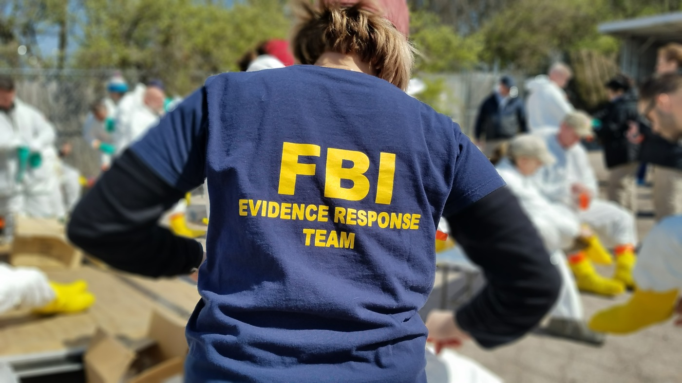 An FBI Evidence Response Team member dons protective gear at the Anthropology Research Center in Knoxville, Tennessee, during the Human Remains Recovery course in March 2018.