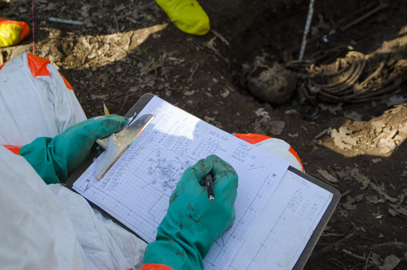 An FBI Evidence Response Team member sketches a burial site at the Anthropology Research Center in Knoxville, Tennessee, during the Human Remains Recovery course in March 2018.