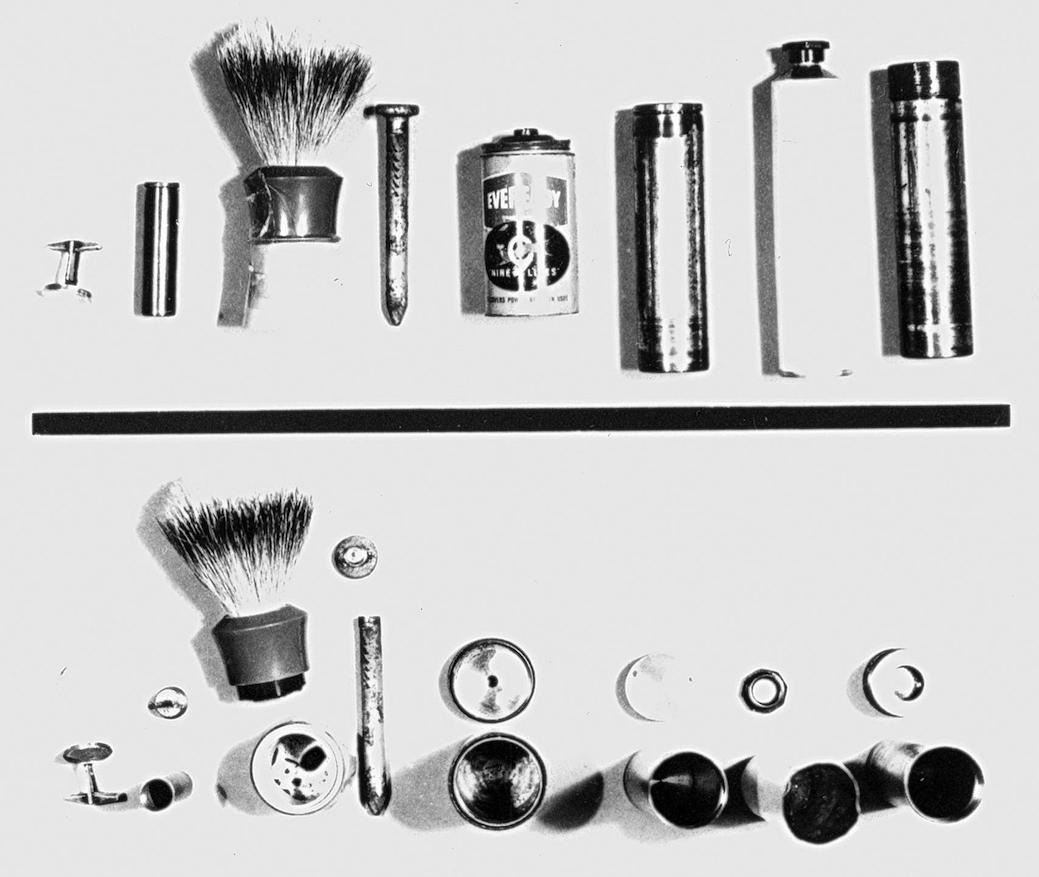 Spying equipment consisting of carefully hollowed containers (shaving brush, batteries, nails, cufflink) for transmitting microfilm messages to Moscow.