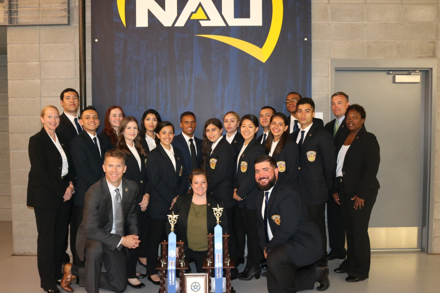 FBI New York Explorers with their FBI advisors pose with the Post's first and second place trophies from the 2016 National Explorer Competition in Flagstaff, Arizona.