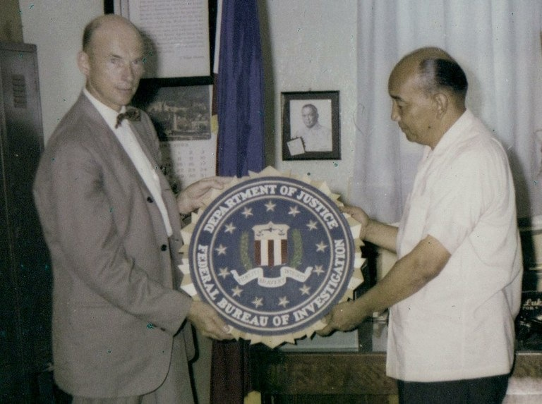 Legat Manila Robert B. Hawley presents Acting Director Jose G. Lukban, National Bureau of Investigation in the Philippines, with an FBI seal in appreciation for his liaison efforts with the FBI. In 1961, Robert B. Hawley opened the first FBI legal attachA(c) in Manila in rooms 416 and 418 of the U.S. Embassy office building.