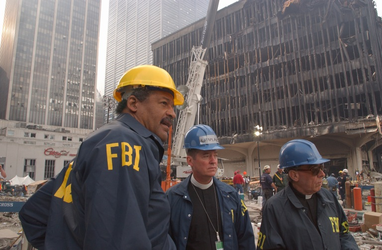 Two FBI chaplains and an agent at Ground Zero in New York after the September 11, 2001 terrorist attacks. (FEMA photo)