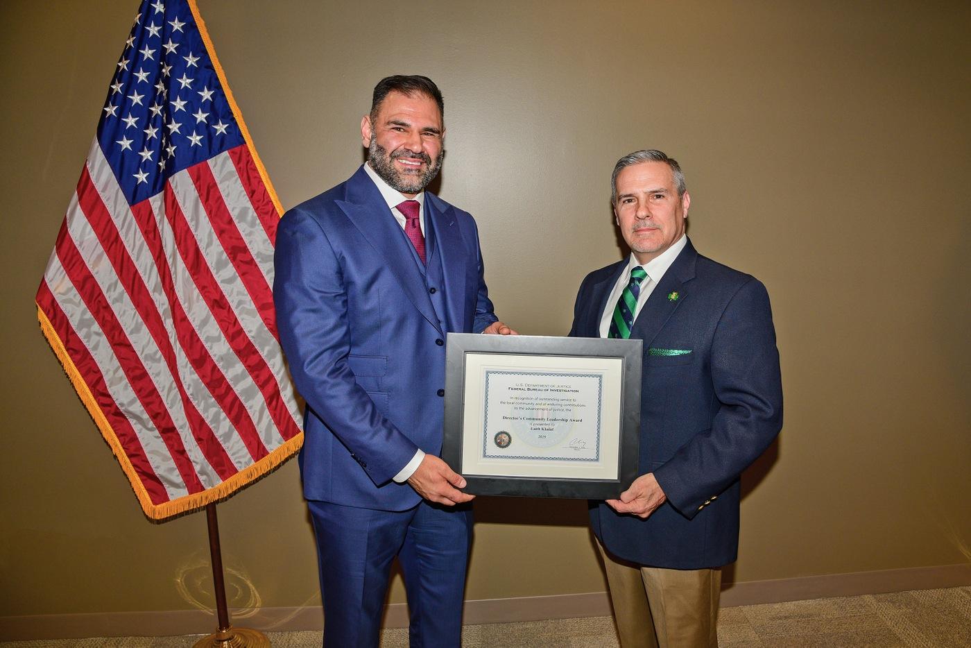 Special Agent in Charge Chris Hoffman of FBI Cincinnati presents the FBI Director's Community Leadership Award to Columbus businessman Laith Khalaf.
