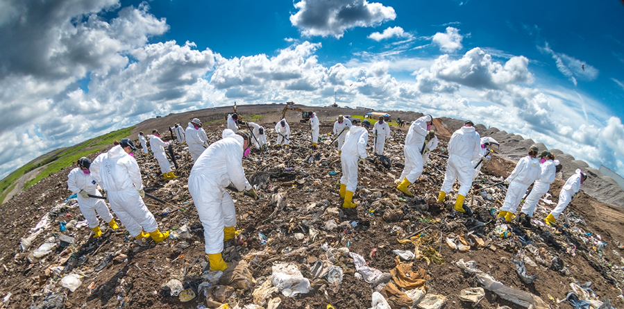 Investigators comb through thousands of pounds of garbage during a landfill search in Florida.