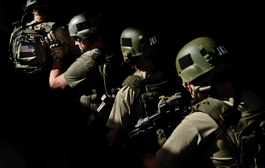 FBI SWAT operators stack up before making entry into a residence.