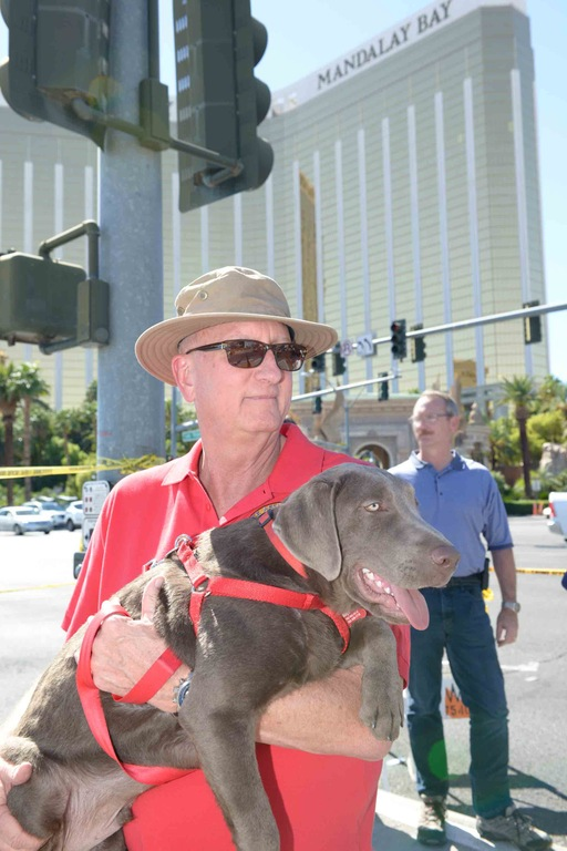 FBI Las Vegas Chaplain Gary Morefield and Wrangler the dog at the scene of the October 1, 2017 mass shooting in Las Vegas