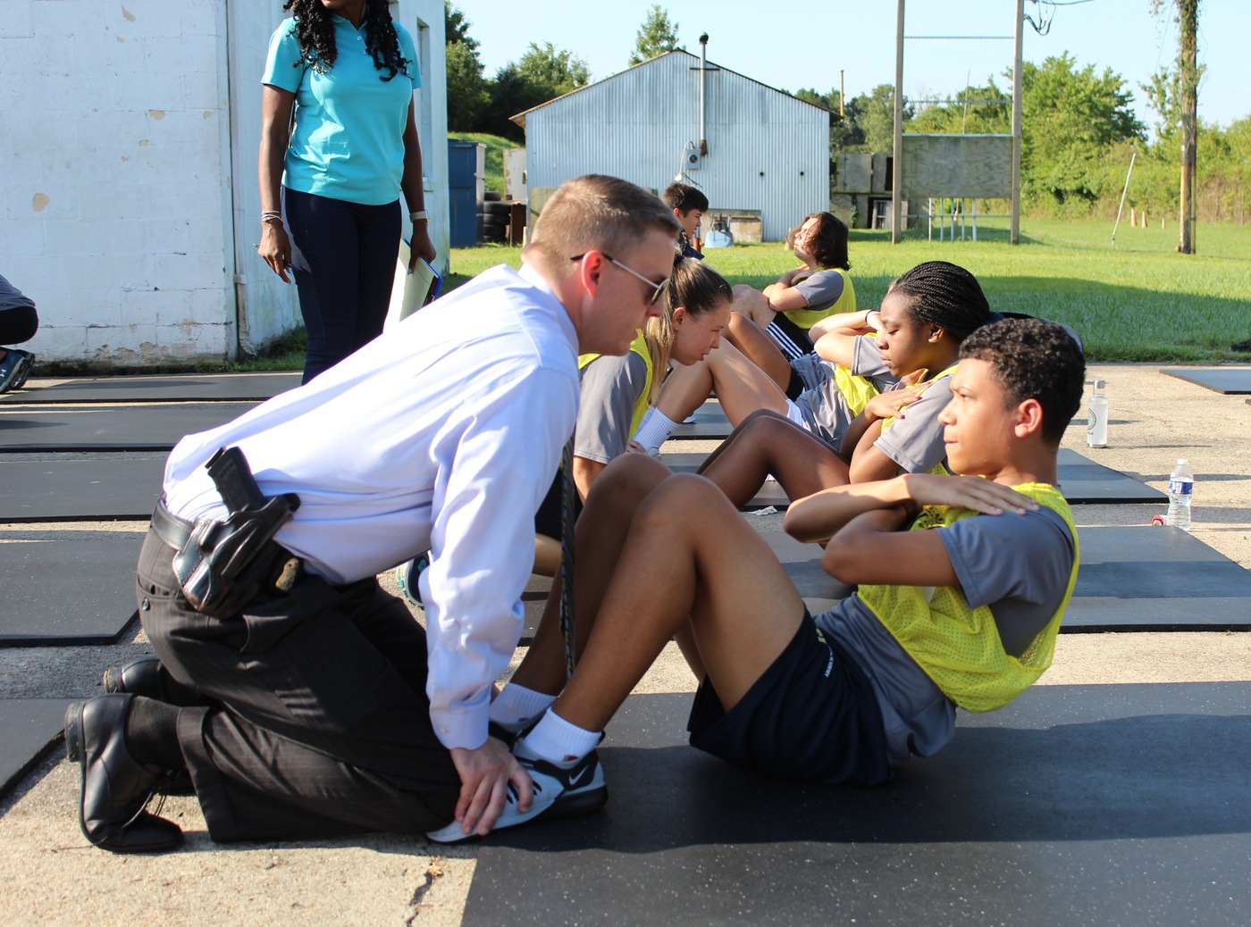 FBI Norfolk Future Agents in Training students do sit-ups.
