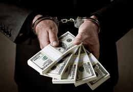 Man in Handcuffs Holding Money