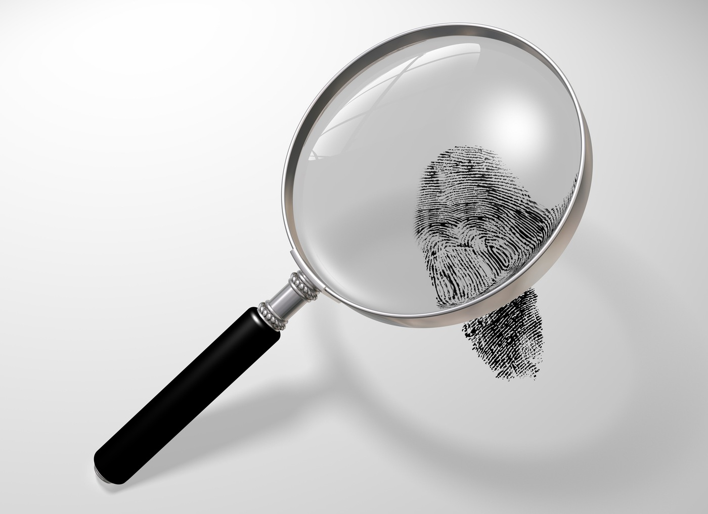 Stock image depicting a fingerprint under a magnifying glass (CJIS Link article)