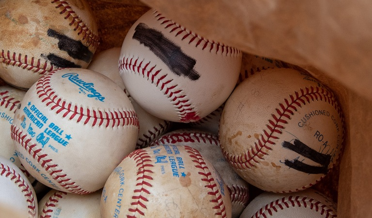 Baseballs with Forged Signatures Blacked Out