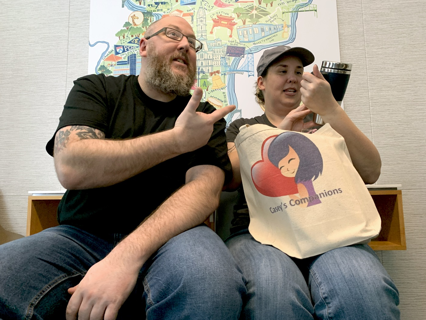 Mark and Nicole Fucci open a bag of items donated by Casey's Companions while at Children's Hospital of Philadelphia.