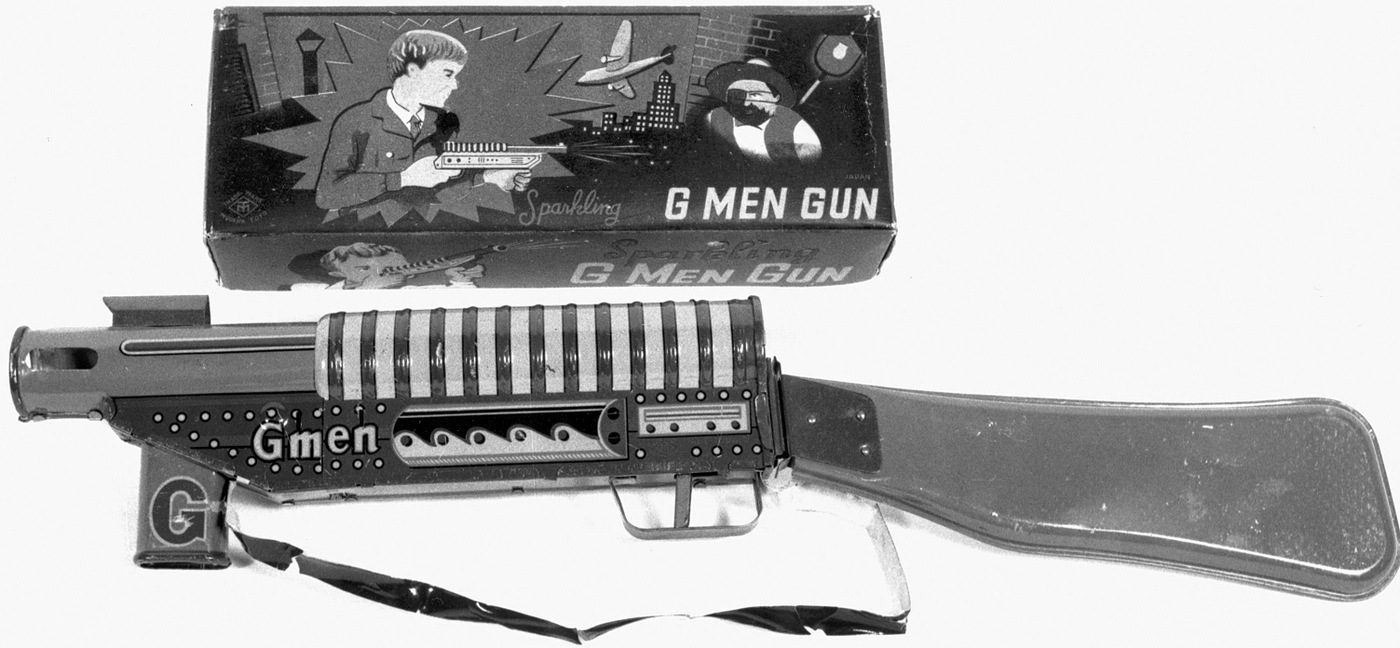 G-Men gun box and submachine gun toy.