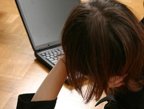 Stock image of a girl using a laptop computer.