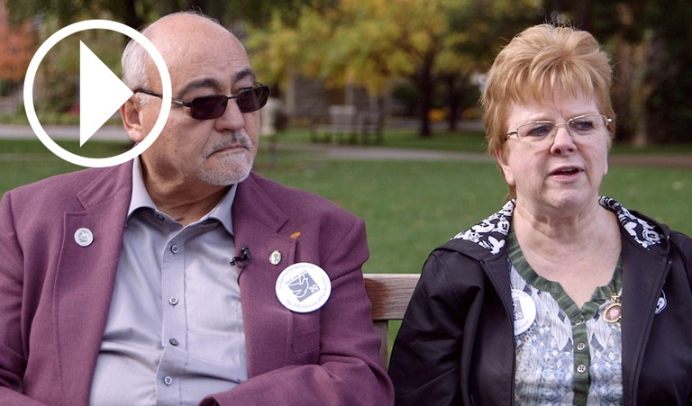 Glenn and Carole Johnson, parents of Pan Am Flight 103 Victim Beth Ann Johnson, with play video symbol overlay.