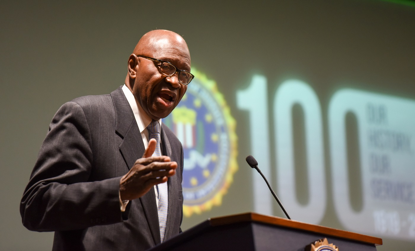 Retired special agent Dr. John Glover speaks at an event marking the 100th anniversary of African-American special agents held at FBI Headquarters on November 8, 2019.