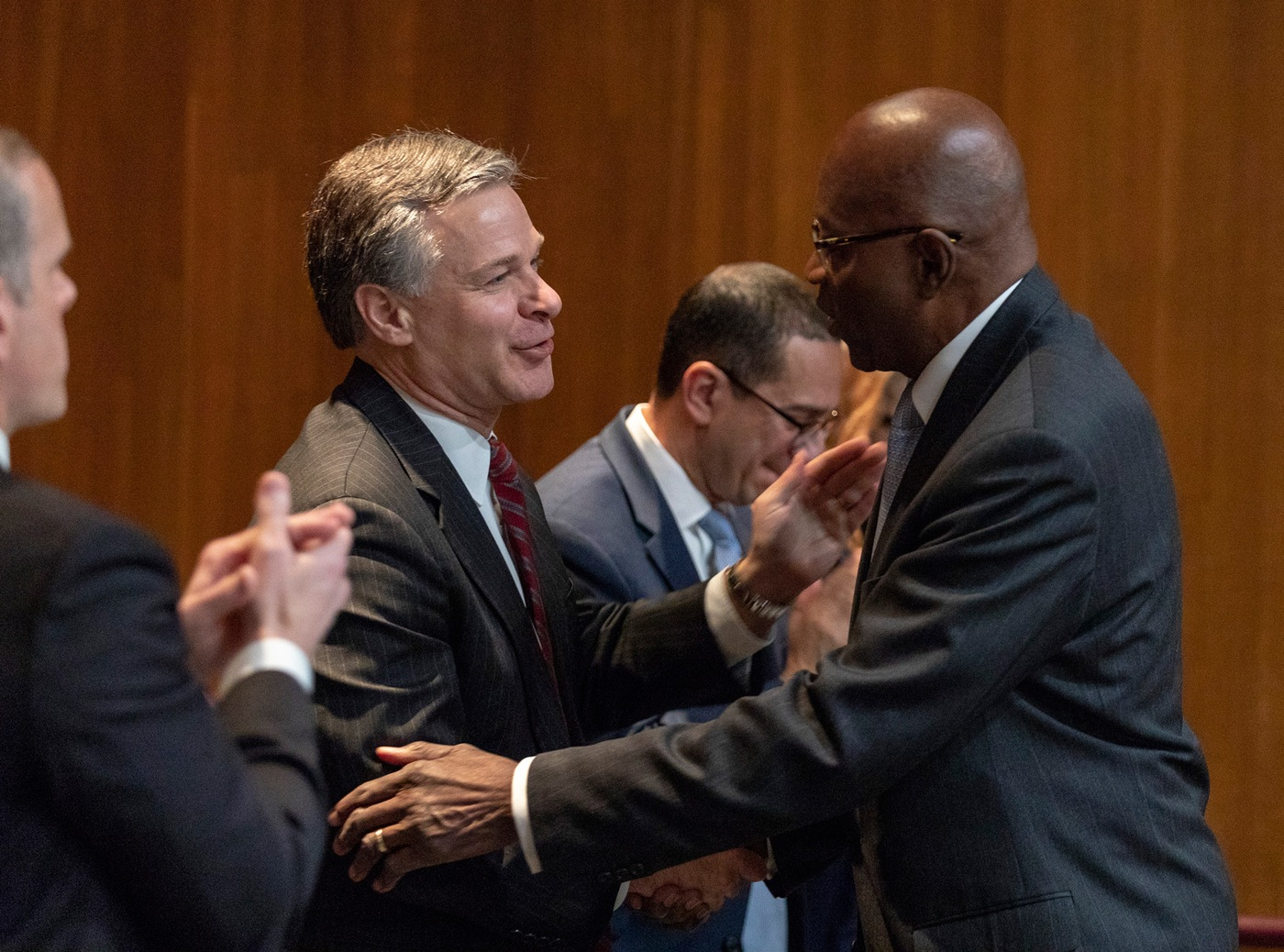 FBI Director Christopher Wray shakes hands with retired special agent Dr. John Glover at an event marking the 100th anniversary of African-American special agents held at FBI Headquarters on November 8, 2019.
