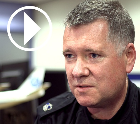 Graeme Galloway, inspector, Police Scotland, with play video symbol overlay.