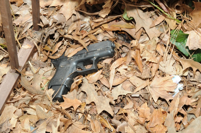 The handgun used during a March 18, 2015 violent bank robbery in Humboldt, Tennessee was recovered by investigators underneath leaves in an alley.