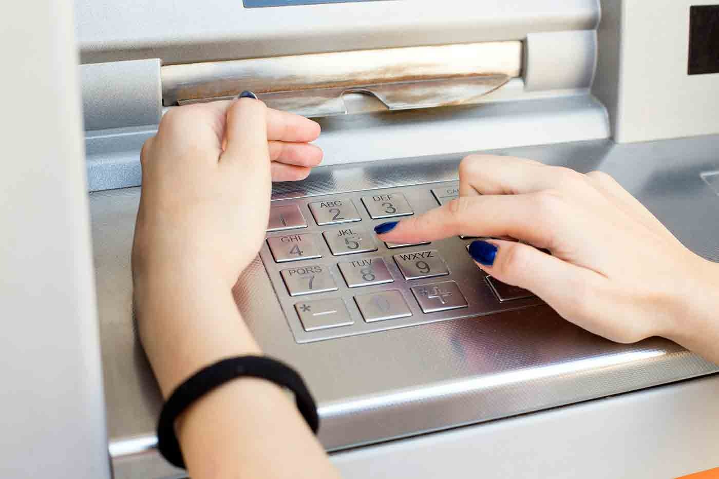 Hands on ATM Keypad (Stock Image)