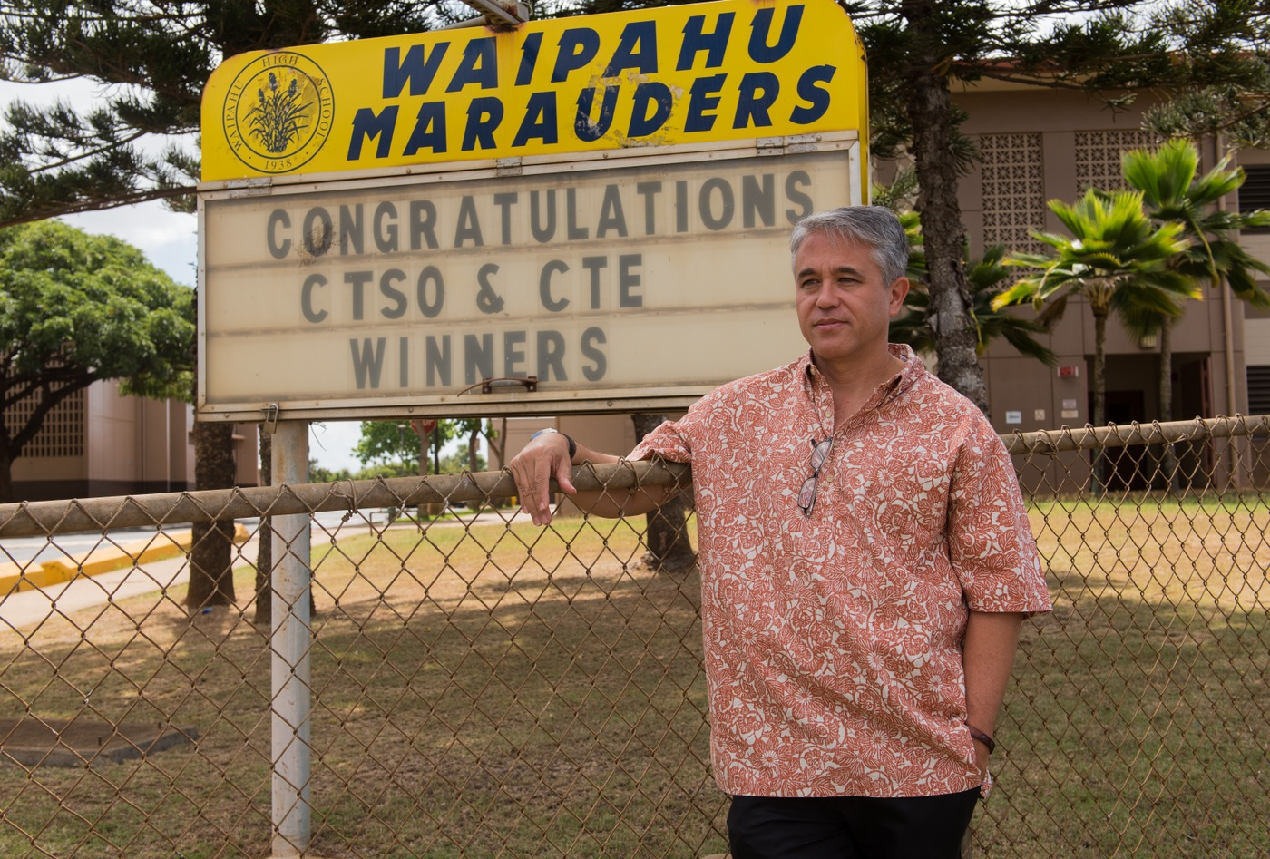 FBI Special Agent Arnold Laanui stands outside Waipahu High School in Honolulu, where he helped start the Honolulu Division's Adopt-a-School program in 2009.