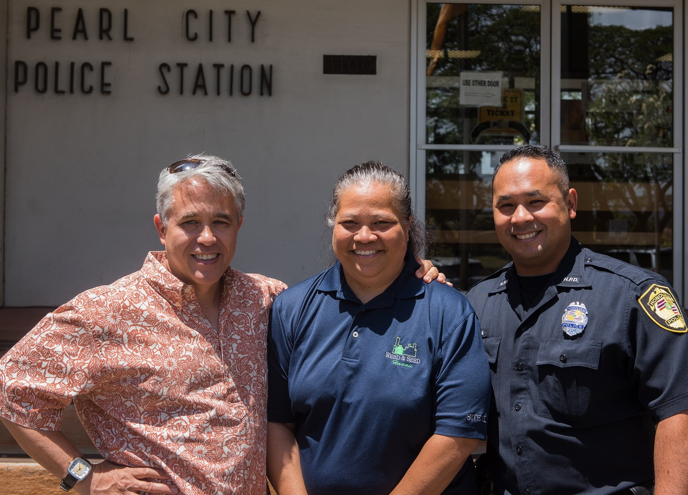 "Special Agent Arnold Laanui, community advocate Lorrie Kanno, and Honolulu Police Department officer Anson ""Kaipo"" Paiva made long-term commitments to the FBI Honolulu Division's Adopt-a-School program at Waipahu High School."