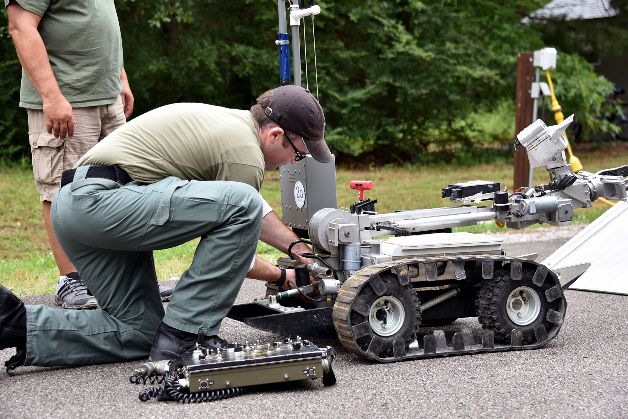 A bomb technician prepares a robot to search for a simulated explosive at the FBI's Hazardous Devices School at Redstone Arsenal in Huntsville, Alabama.