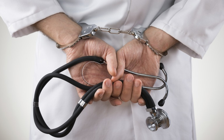 Health Care Professional in Handcuffs