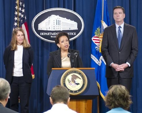 Attorney General Loretta Lynch—joined by HHS Secretary Sylvia Mathews Burwell (left) and FBI Director James B. Comey—speaks at a press conference announcing charges in the largest-ever health care fraud takedown in terms of both loss amounts and arrests on June 18, 2015.