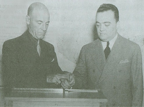 Courtney Ryley Cooper rolls J. Edgar Hoover's fingerprints, circa 1936. National Archives photo.