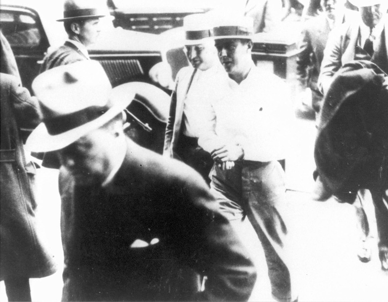 FBI Director J. Edgar Hoover, left, after the arrest of Alvin Karpis in New Orleans on May 1, 1936.